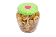 Pickled button mushrooms in glass jar Royalty Free Stock Photo