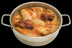 Pickled Cabbage Stuffed Rolls Cooked With Smoked Pork Ribs in Stainless Steel Saucepot On Black Background. Traditional Serbian gourmet dish Sarma, consisted of Royalty Free Stock Photo