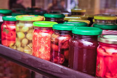 Pickled canned vegetables in colorful jars Royalty Free Stock Photo