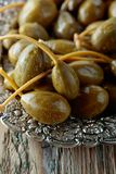 Pickled caper berries in metal dish . Royalty Free Stock Photos