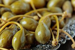 Pickled caper berries . Edible fruits of Capparis . Berries are used as garnish Stock Images
