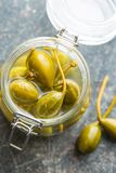 Pickled caper berries. Stock Photo