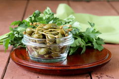 Pickled capers  in  bowl Stock Image