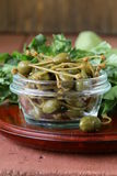 Pickled capers  in  bowl Stock Photos