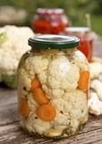 Pickled cauliflower. And carrot in glass bottle Stock Photo