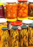 Pickled chili peppers in jars Royalty Free Stock Photo