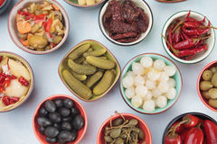 Pickled cucumber, olives and vegetables Stock Photography