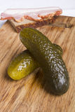 Pickled cucumbers on a cutting board Stock Image