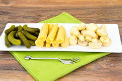 Pickled Cucumbers Gherkins, Mushrooms and Corn Stock Images
