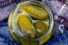 Pickled cucumbers in glass jar Stock Photo