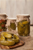 Pickled cucumbers in glass jars traditional salted homemade marinated vegetables Stock Photo
