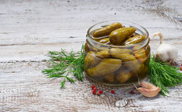 Pickled cucumbers, homemade preserved in jar. Pickled cucumbers, homemade preserved. Selective focus. Space for text Royalty Free Stock Photos