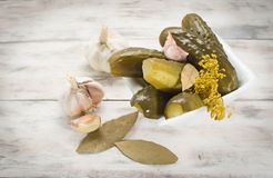 Pickled cucumbers. Homemade pickled cucumbers in wooden bacground Royalty Free Stock Photos