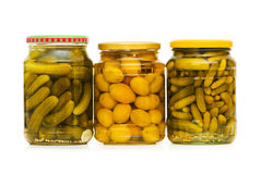 Pickled cucumbers and olives Stock Image
