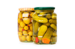 Pickled cucumbers and olives in glass Royalty Free Stock Image