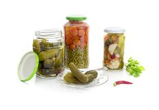 The pickled vegetables in jars Royalty Free Stock Photo