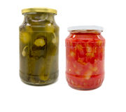 Pickled cucumbers and peppers in tomato sauce in jar Royalty Free Stock Photos