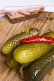 Pickled cucumbers with red hot pepper on a cutting board Royalty Free Stock Images