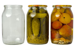 Pickled cucumbers and tomatoes in jars. Salted cucumbers and tomatoes in homemade salted cans on white background Stock Photos