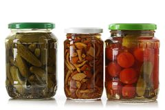 Pickled cucumbers, tomatoes and mushrooms. Stock Photography