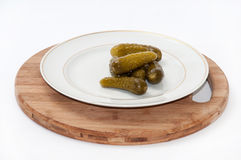 Pickled cucumbers on a wooden board Royalty Free Stock Photo