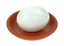 Pickled egg in small red clay bowl Stock Images