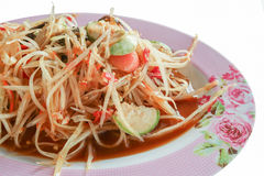Pickled fish papaya Salad, Som tum, Thai food in pink plate. Close up on white background royalty free stock photo