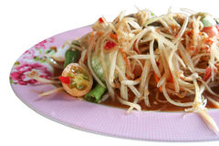 Pickled fish papaya Salad, Som tum, Thai food in pink plate. Close up on white background stock photos