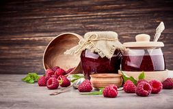 Pickled fruits fresh raspberry berries confiture. Pickled ts fresh raspberry berries confiture on old wooden board in rustic style with copyspace Royalty Free Stock Photography