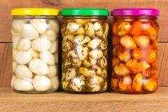 Pickled garlic in the pot Stock Images