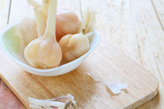 Pickled garlic in white bowl Royalty Free Stock Image