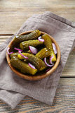 Pickled gherkins in a bowl Stock Images
