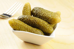 Pickled gherkins in a small bowl Royalty Free Stock Images