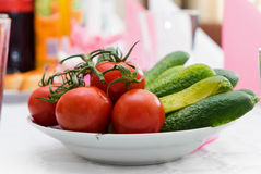 Pickled green gherkins and Fresh tomato  in  bowl on the table Royalty Free Stock Photo