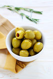 Pickled green olives in bowl Stock Image