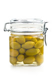 Pickled green olives in jar Royalty Free Stock Photography