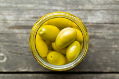 Pickled green olives in jar Royalty Free Stock Photos