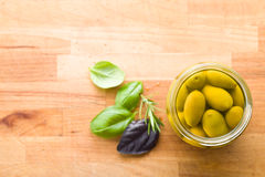Pickled green olives in jar Stock Photography