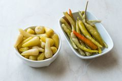 Pickled Green Pepper Pickles in Bowls. Traditional Organic Food royalty free stock image