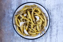 Pickled green pepper in a plate Royalty Free Stock Photo