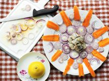 Pickled hering,onion circle and carrot stripe in sun shape Stock Photo