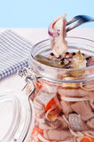 Pickled Herring. On a fork from a jar Stock Photos
