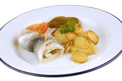 Pickled herring with fried potatoes Royalty Free Stock Photography