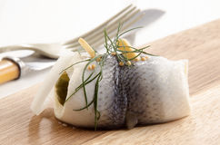 Pickled herring with gherkin and onion Royalty Free Stock Images