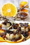 Pickled herring rolls with dried fruits and plum sauce Stock Photography
