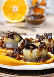 Pickled herring rolls with dried fruits and plum sauce Stock Photo