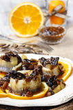 Pickled herring rolls with dried fruits and plum sauce Stock Photos