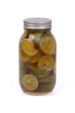 Pickled honey and lemon in a bottle. Stock Photography