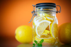 Pickled lemons in sugar syrup Royalty Free Stock Photo