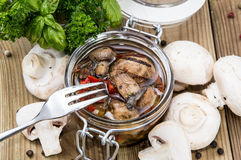 Pickled mushrooms in a glass Stock Photos